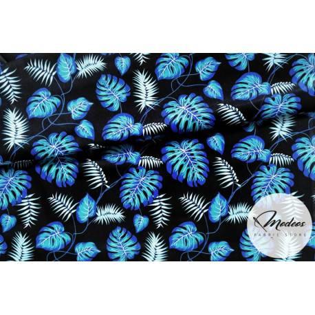 Materiał niebieskie liście palmy monstera na czarnym - bawełna