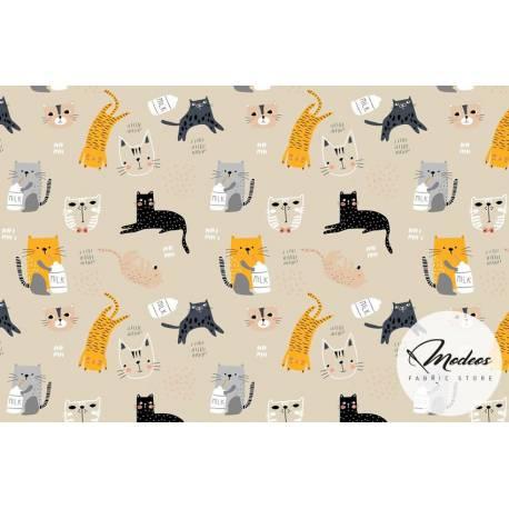 Tkanina koty kotki na kremowym tle - materiał bawełna