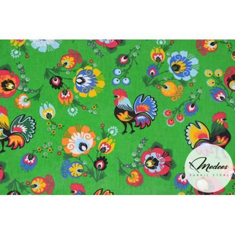 Materiał koguty łowickie kwiaty na zielonym tle - bawełna tkanina