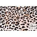 Tkanina panterka na morelowym tle - materiał bawełna