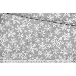 Białe śnieżynki, płatki śniegu na szarym tle - tkanina bawełniana