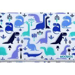 Niebieskie dinozaury na białym tle - tkanina bawełniana